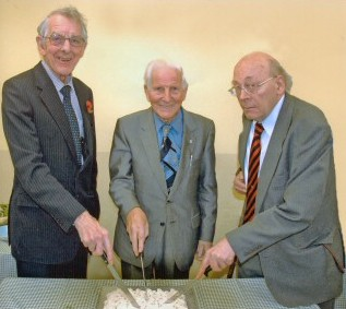 Three man and a cake